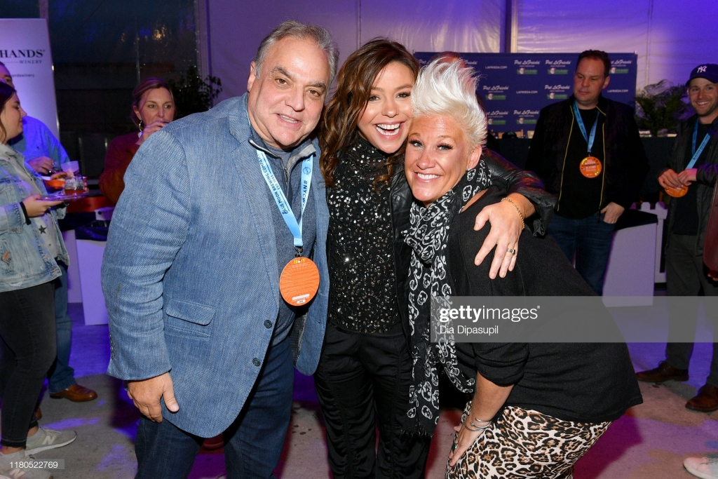 NEW YORK, NEW YORK - OCTOBER 11: Lee Schrager, Rachael Ray and Anne Burrell attend the Blue Moon Burger Bash presented by Pat LaFrieda Meats hosted by Rachael Ray at Pier 97 on October 11, 2019 in New York City. (Photo by Dia Dipasupil/Getty Images for NYCWFF)