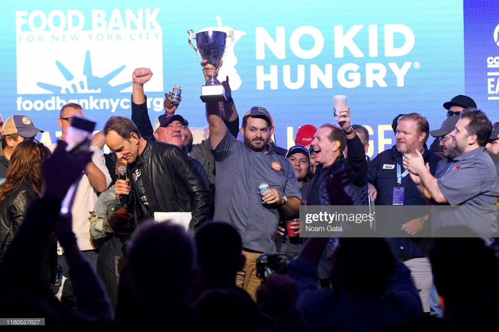 NEW YORK, NEW YORK - OCTOBER 11:  Winner of Blue Moon Burger Bash's People's Choice Award Matt Abdoo of Pig Beach poses onstage  the Blue Moon Burger Bash presented by Pat LaFrieda Meats hosted by Rachael Ray at Pier 97 on October 11, 2019 in New York City. (Photo by Noam Galai/Getty Images for NYCWFF)
