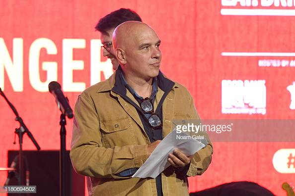 NEW YORK, NEW YORK - OCTOBER 12: Michael Symon speaks onstage during Titans of BBQ presented by National Beef and Pat LaFrieda Meats hosted by Dario Cecchini, Pat LaFrieda and Michael Symon at Pier 97 on October 12, 2019 in New York City. (Photo by Noam Galai/Getty Images for NYCWFF)