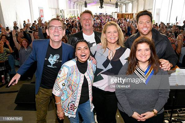 NEW YORK, NEW YORK - OCTOBER 13: (L-R) Ted Allen, Maneet Chauhan, Marc Murphy, Amanda Freitag, Scott Conant, and Alex Guarnaschelli pose onstage during Sunday Brunch hosted by Marc Murphy and Devour Power at Pier 97 on October 13, 2019 in New York City. (Photo by Dia Dipasupil/Getty Images for NYCWFF)
