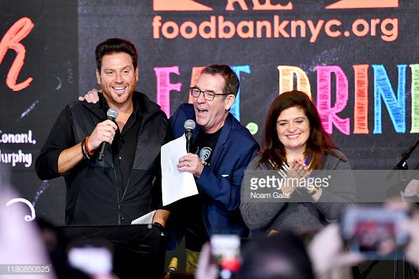 NEW YORK, NEW YORK - OCTOBER 13: Scott Conant, Ted Allen and Alex Guarnaschelli speak onstage during Sunday Brunch hosted by Marc Murphy and Devour Power at Pier 97 on October 13, 2019 in New York City. (Photo by Noam Galai/Getty Images for NYCWFF)